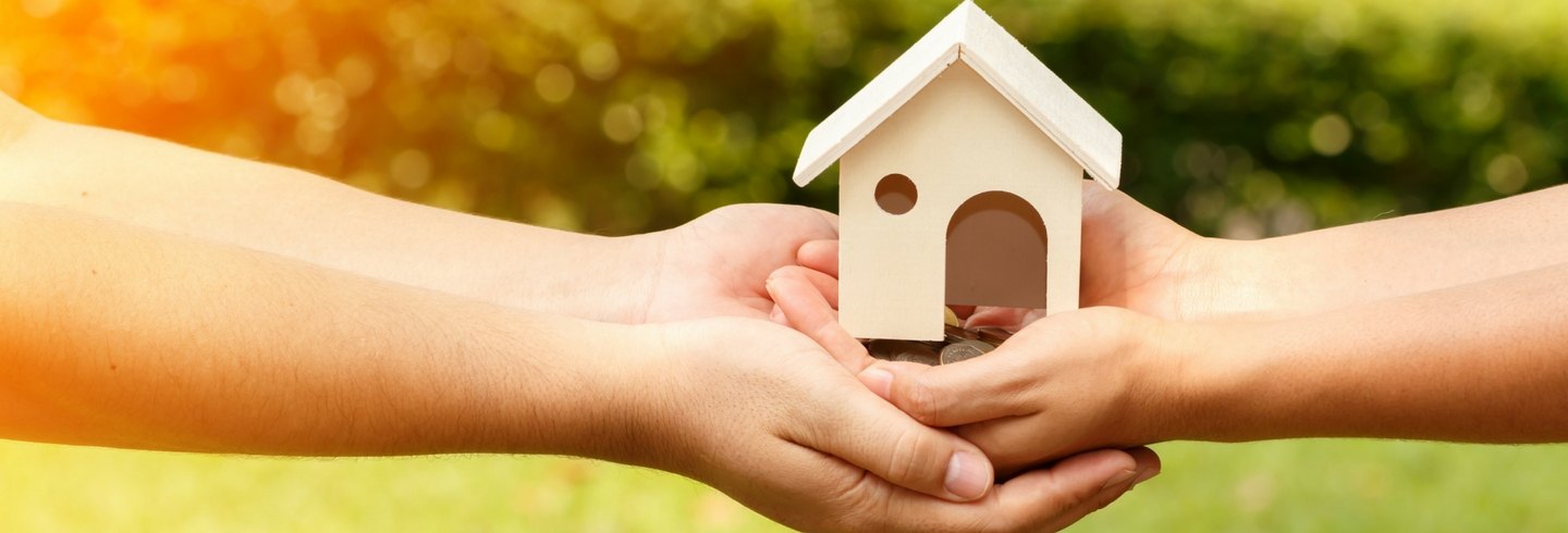 House in hands 1440x490 shutterstock_493817038