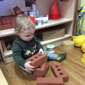 Child with bricks