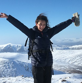 Young woman celebrating in mountains
