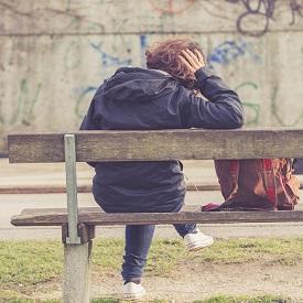 girl-sitting-bench-275px