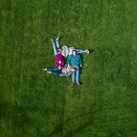 unsplash family grass drone view