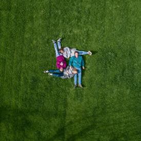 unsplash family grass drone view