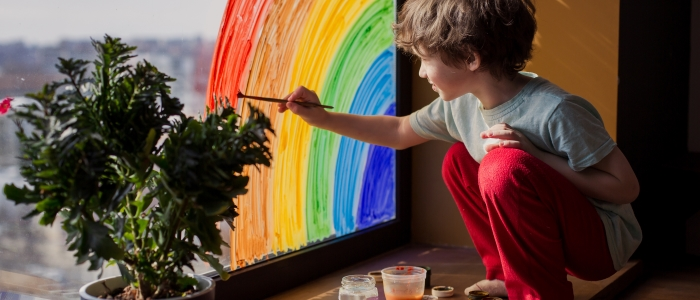 child painting a rainbow 2020 covid 19 crisis