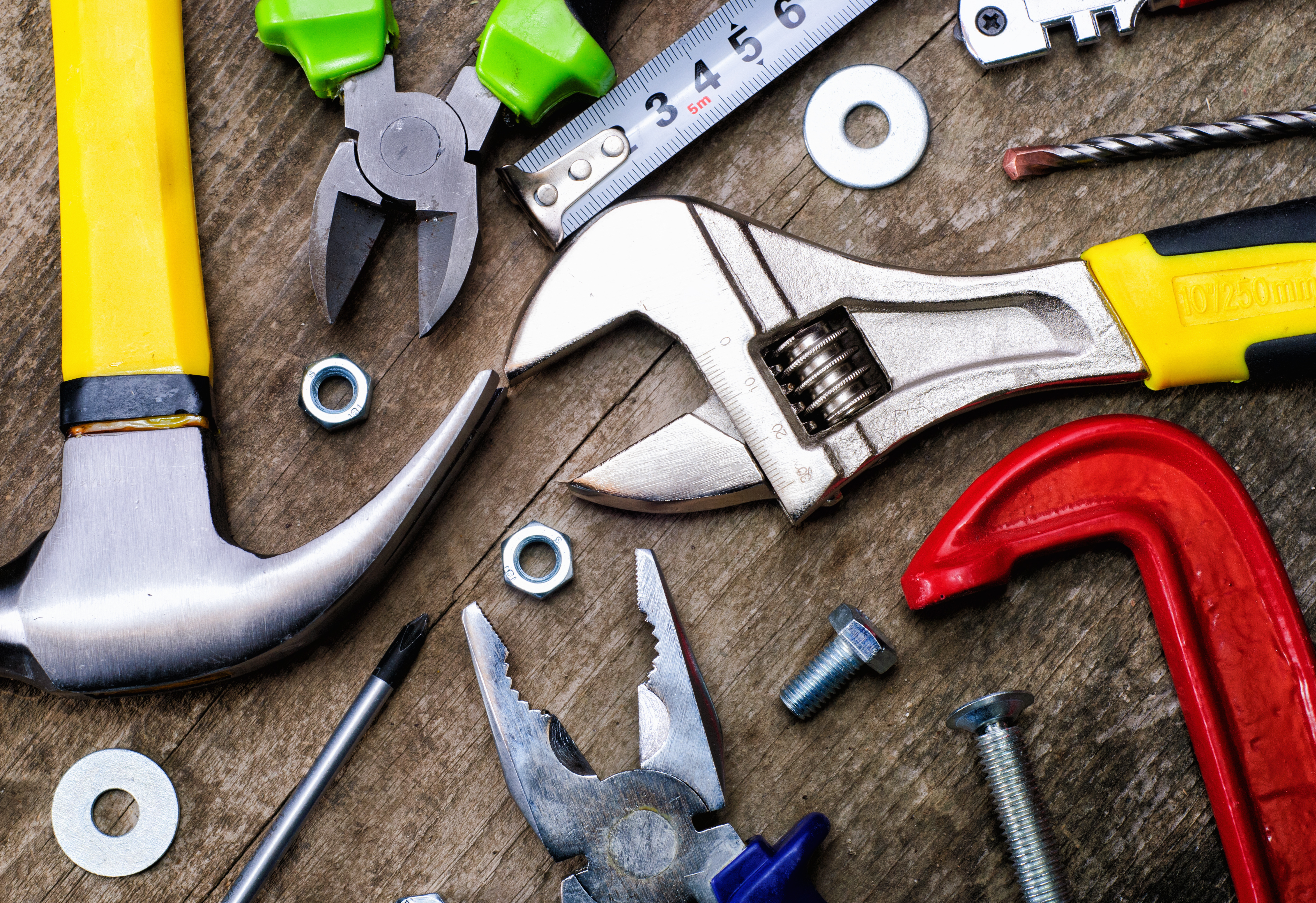 DIY tools on a wooden background