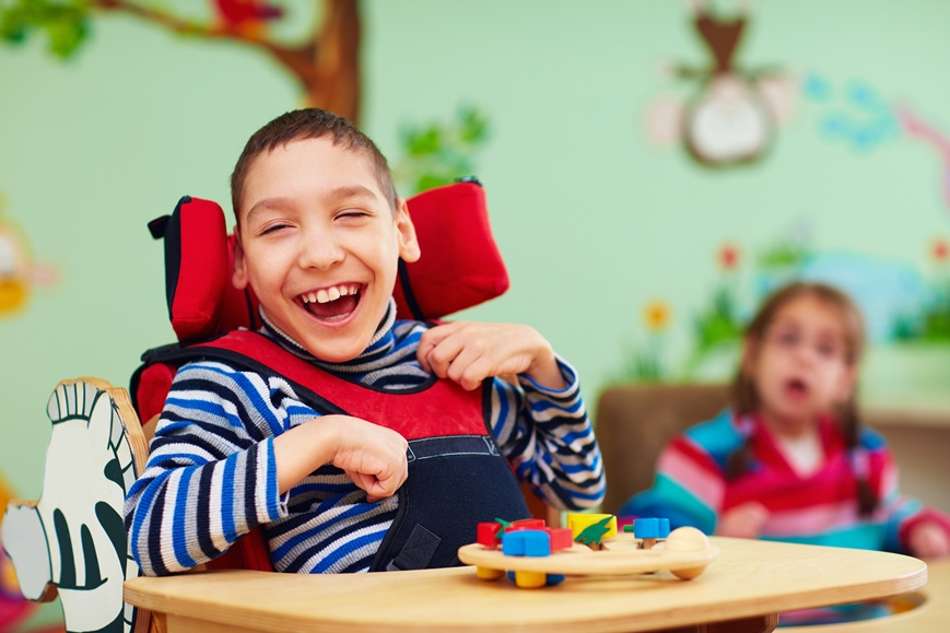 young special needs boy smiling