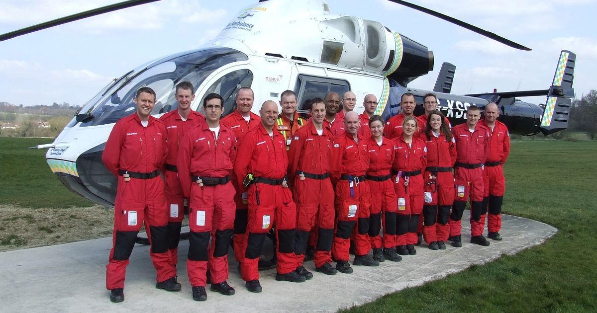 Kent, Surrey and Sussex Air Ambulance crew standing in front of helicopter