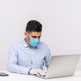 Businessman wearing protective mask