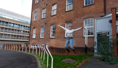 jumping for joy outside new charity home