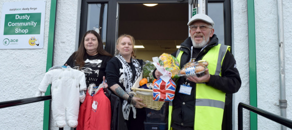 People carrying food and clothes donations at Action in Caerau and Ely