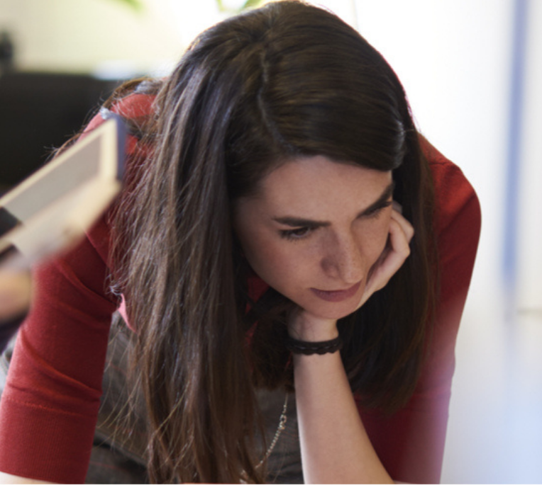 Woman leans over working
