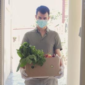 Charity worker wearing mask