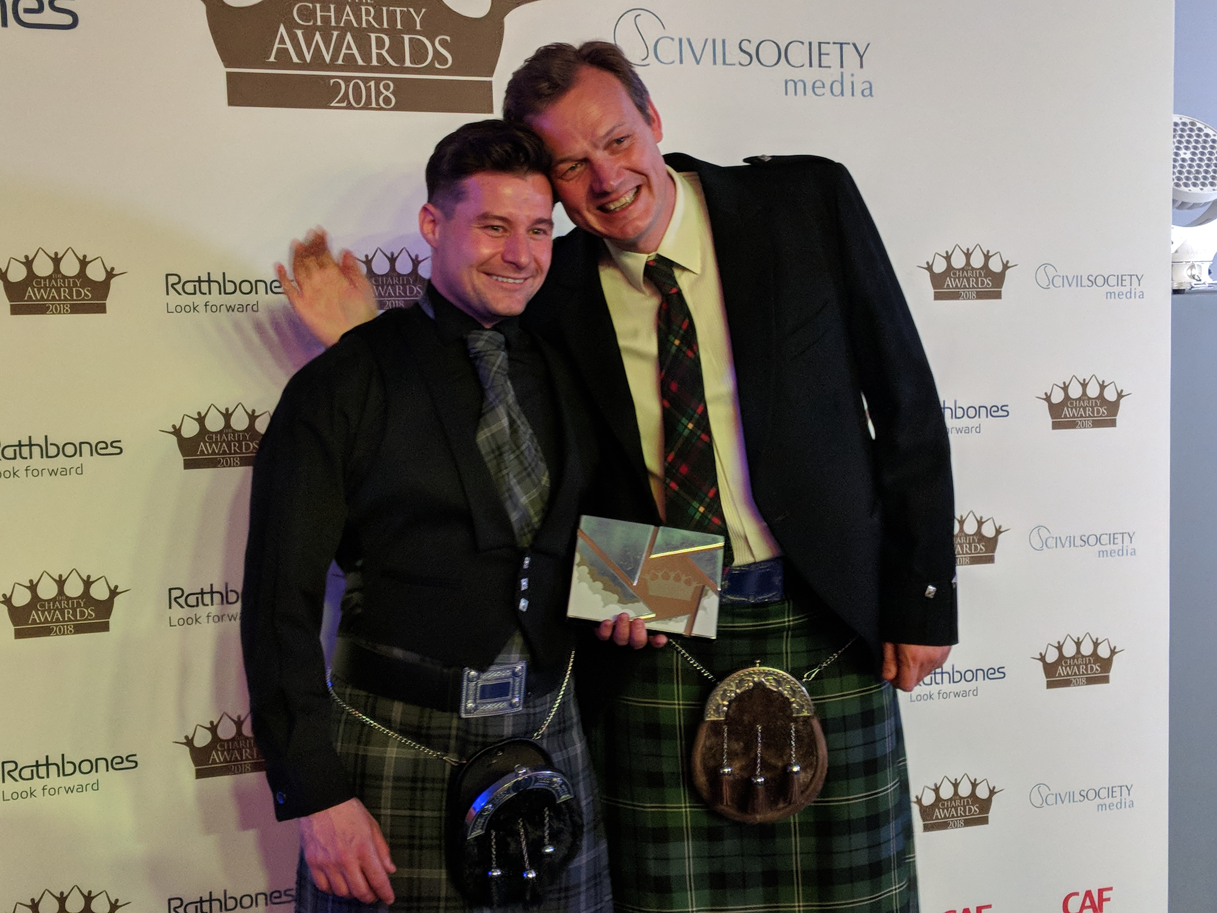 Who Cares? Scotland pose with their award at the Charity Awards