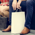 Man sitting with shopping bag