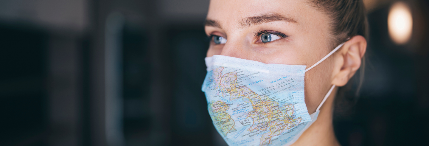 Woman with mask with UK map