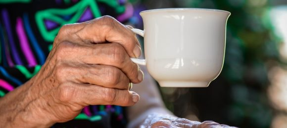 elderly lady holding cup case study image 580 260 unsplash claudia van zyl