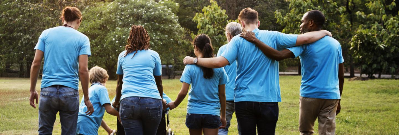 Group of volunteers hugging
