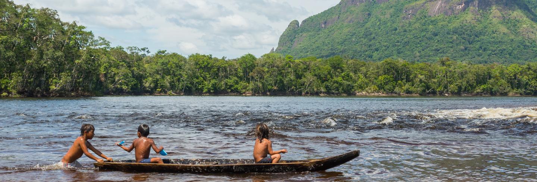 kids in boat in amazonas
