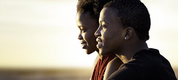 Ugandan man and women looking into distance