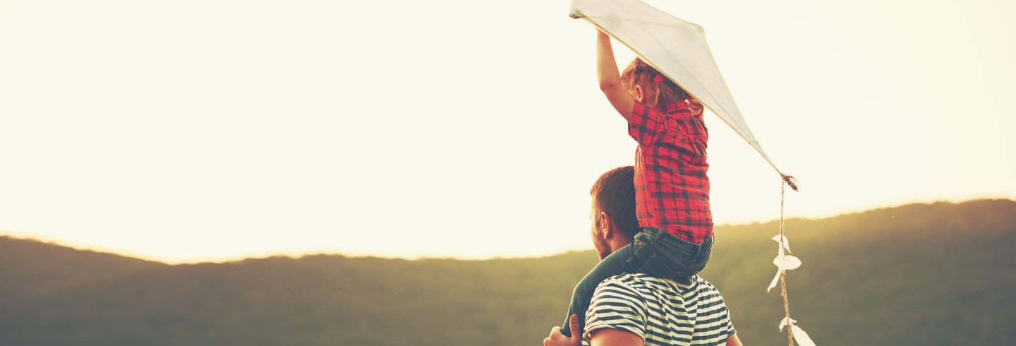 happy-family-father-and-child-on-meadow-with-a-kite