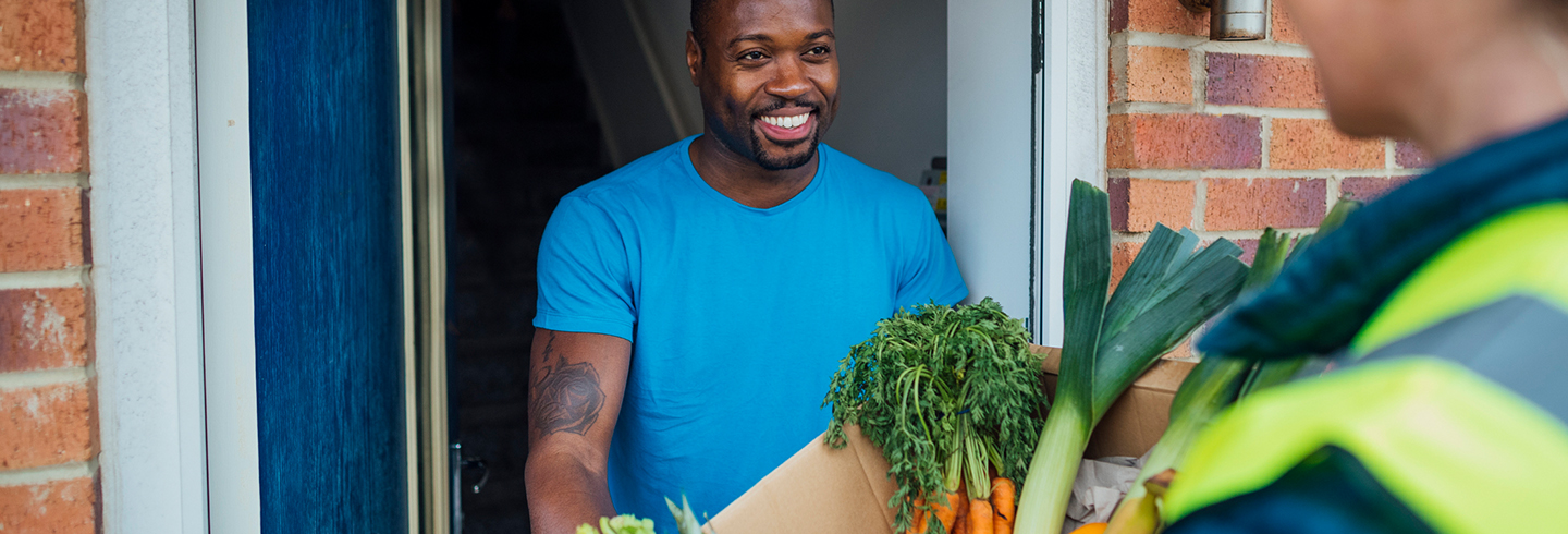 Man delivering a veg box delivery