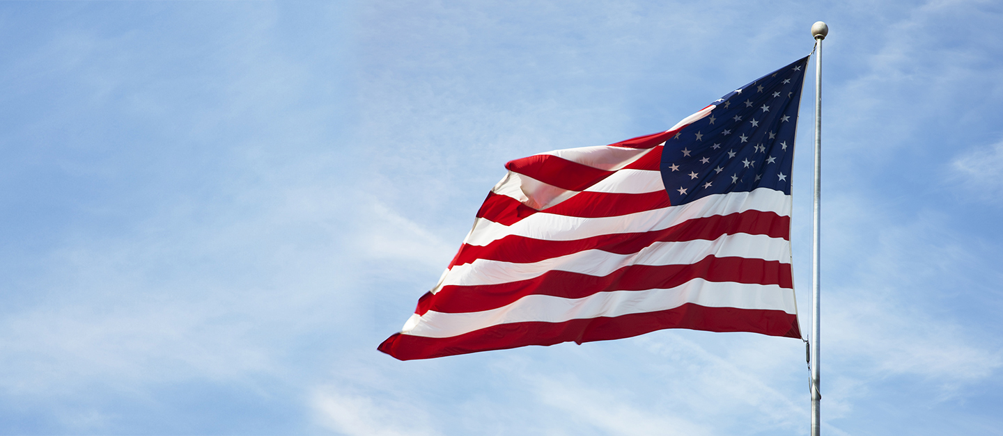 The cover of our Charitable Giving in the USA report which is an image of the US flag