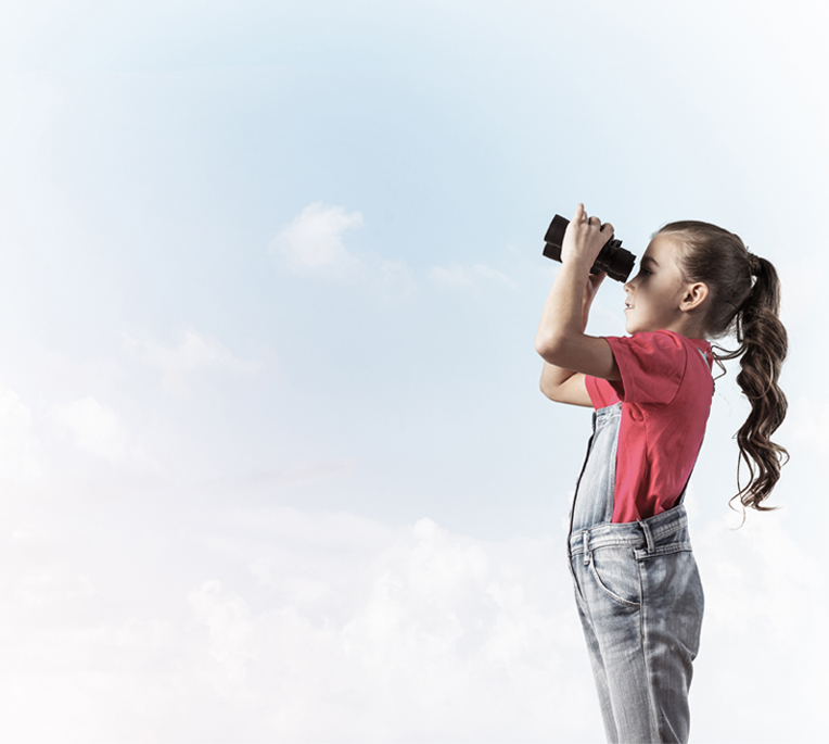 Little girl against sky background dreaming about future
