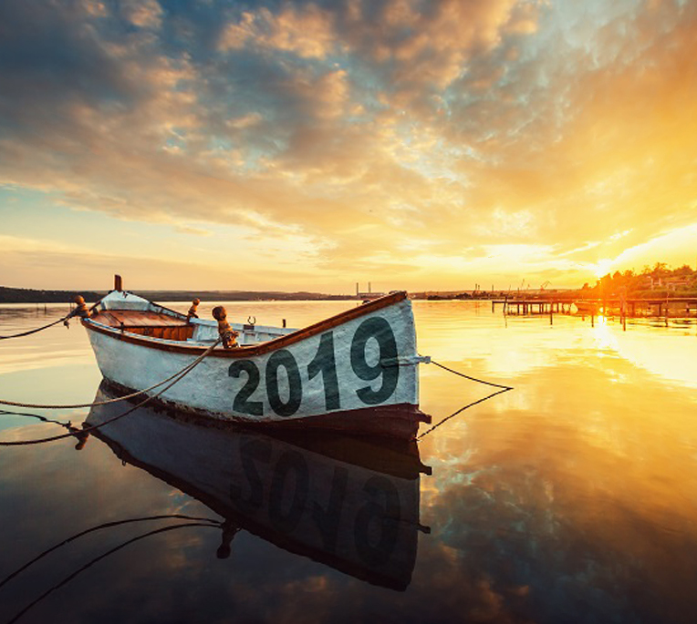 Boat at sunset with 2019 painted on it