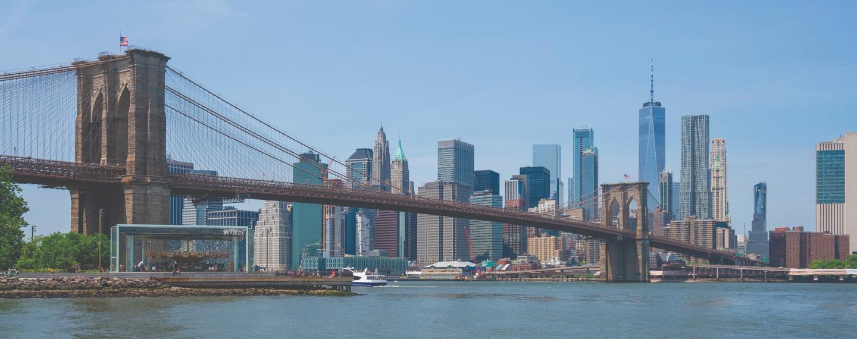 View of Manhattan skyline and Brooklyn Bridge in daytime